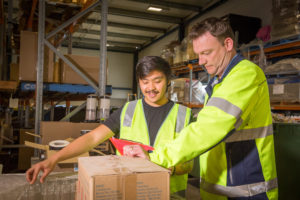 Two Warehouse Workers Preparing Stock